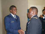 Lt. Brandan Ward receiving congratulations from General Moore of the USAF